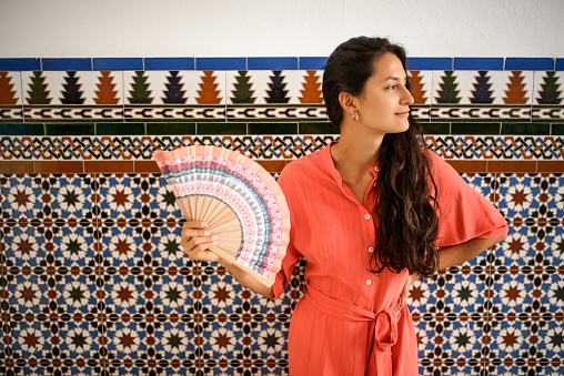 istock Beautiful woman using hand fan. 1031141966