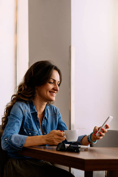 Beautiful woman using her mobile. stock photo