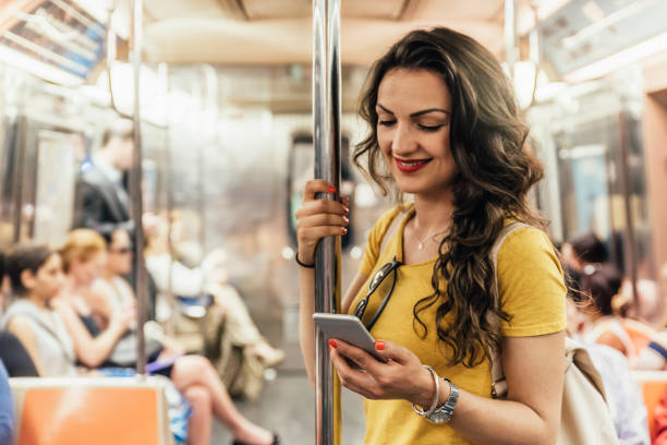 Beautiful woman using phone. Beautiful woman using phone in the subway of New York. subway stock pictures, royalty-free photos & images