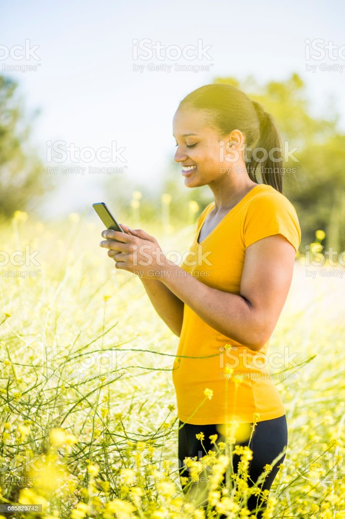 Beautiful Woman Using Smartphone stock photo