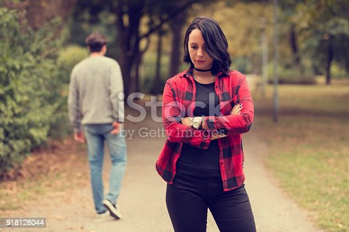 istock Beautiful woman waiting for boyfriend outdoors. Love or break up concept. 918128044