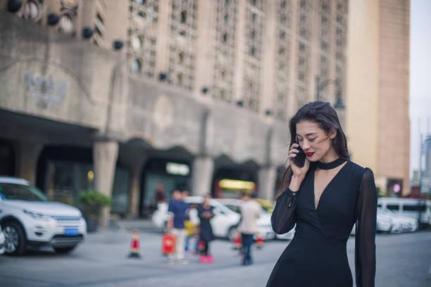 Beautiful woman walking down the street stock photo