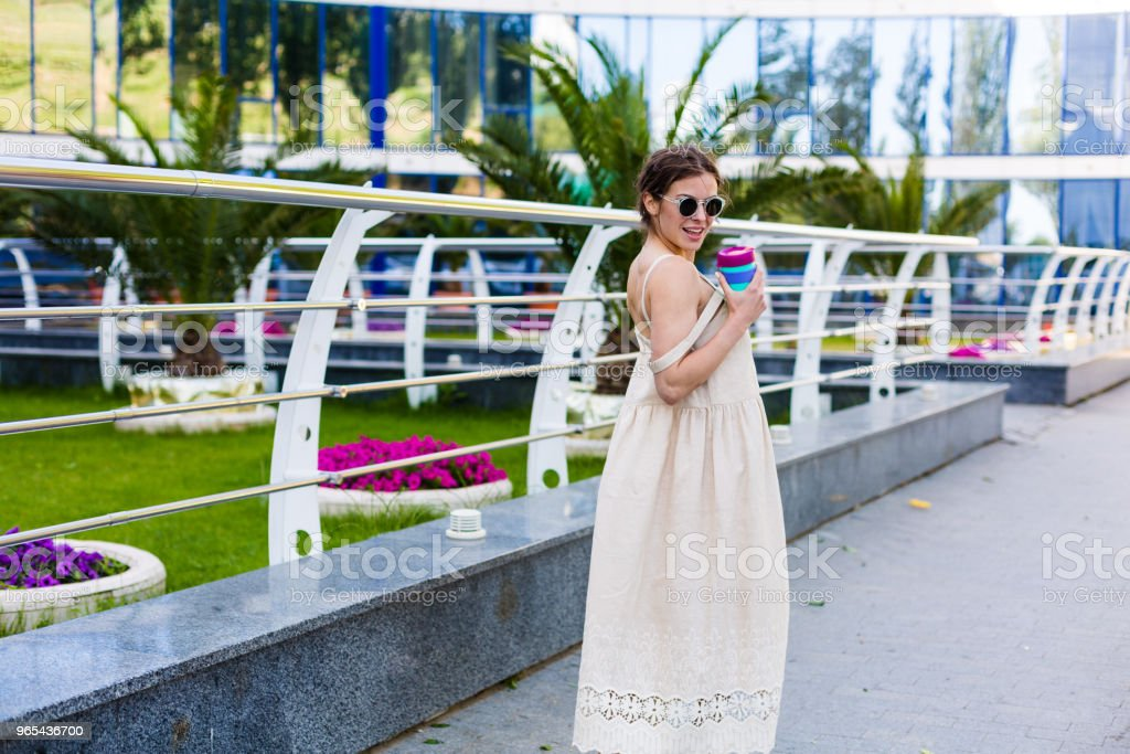 Beautiful woman walking in the summer city zbiór zdjęć royalty-free