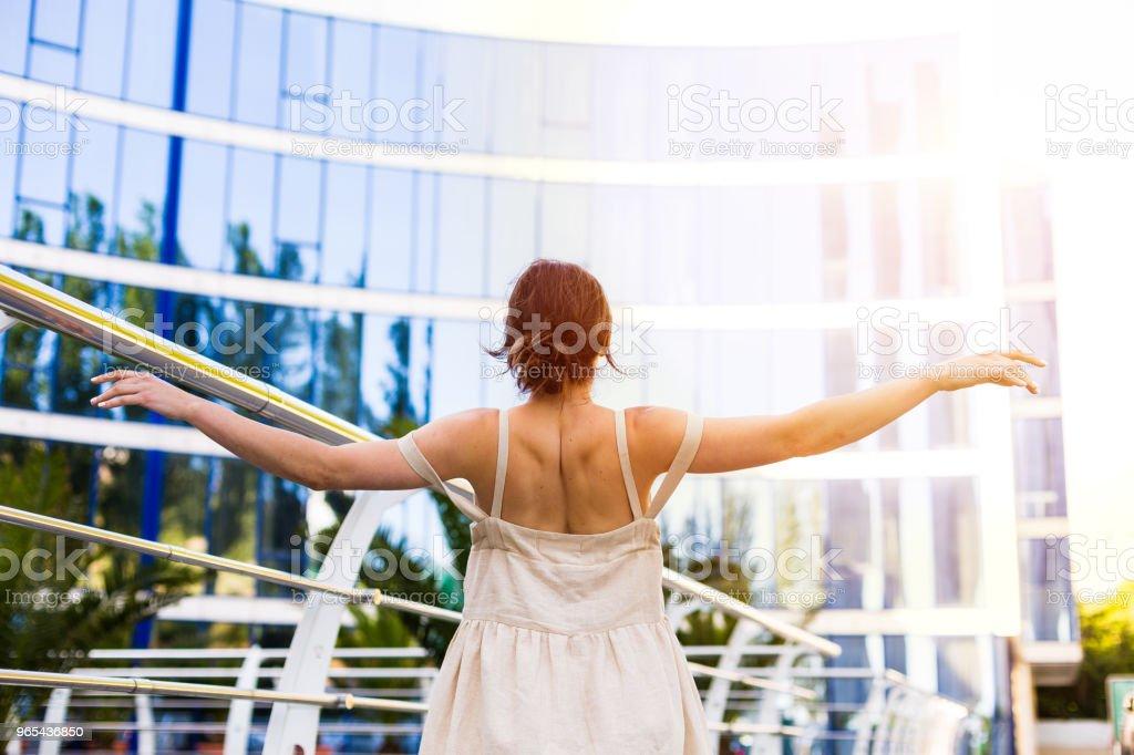Beautiful woman walking in the summer city zbiór zdjęć royalty-free