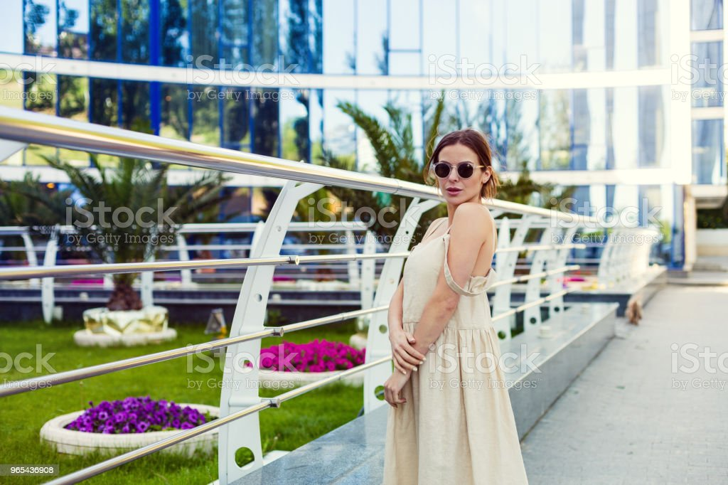 Beautiful woman walking in the summer city royalty-free stock photo