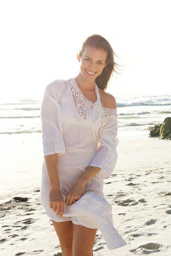 Beautiful Woman Walking On Beach With Sun Dress Stock ...