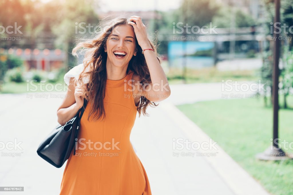 Beautiful woman walking outdoors on a sunny day stock photo