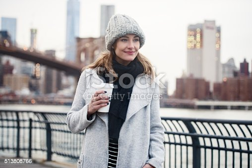 654490824 istock photo Beautiful woman walking with coffee cup in New York City 513808766