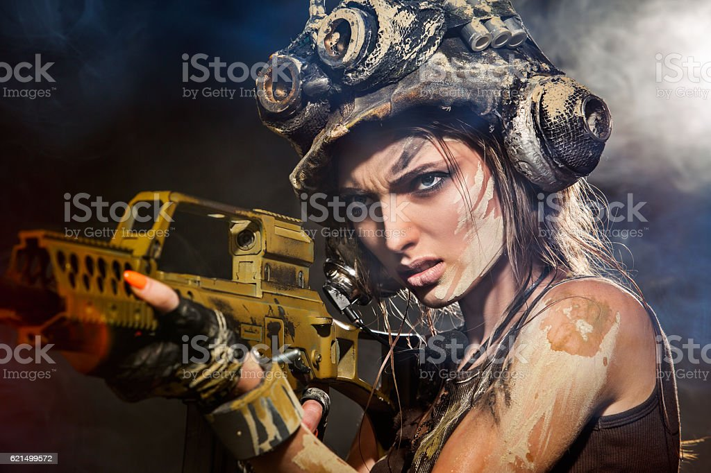 Beautiful woman warrior with arms Lizenzfreies stock-foto