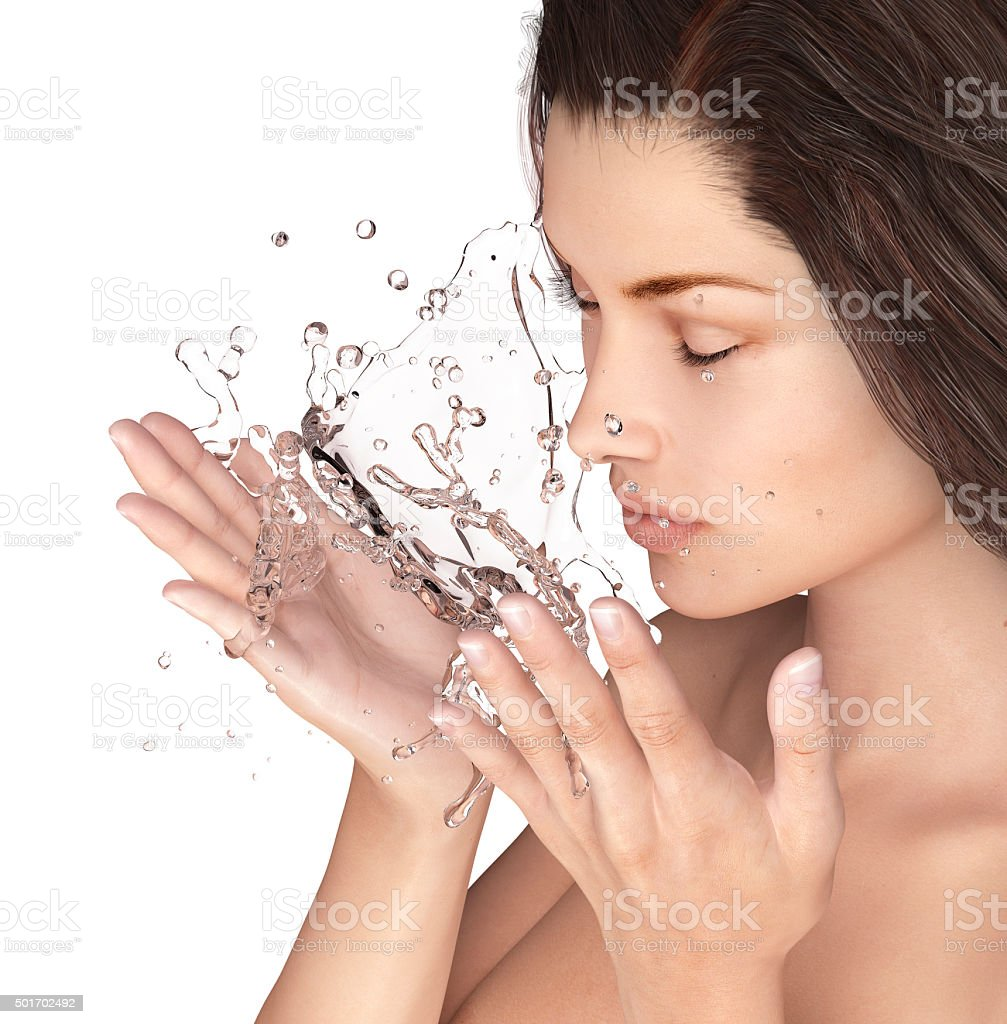 Beautiful woman washing her face isolated stock photo