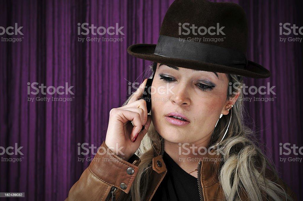 beautiful woman wearing a bowler hat royalty-free stock photo