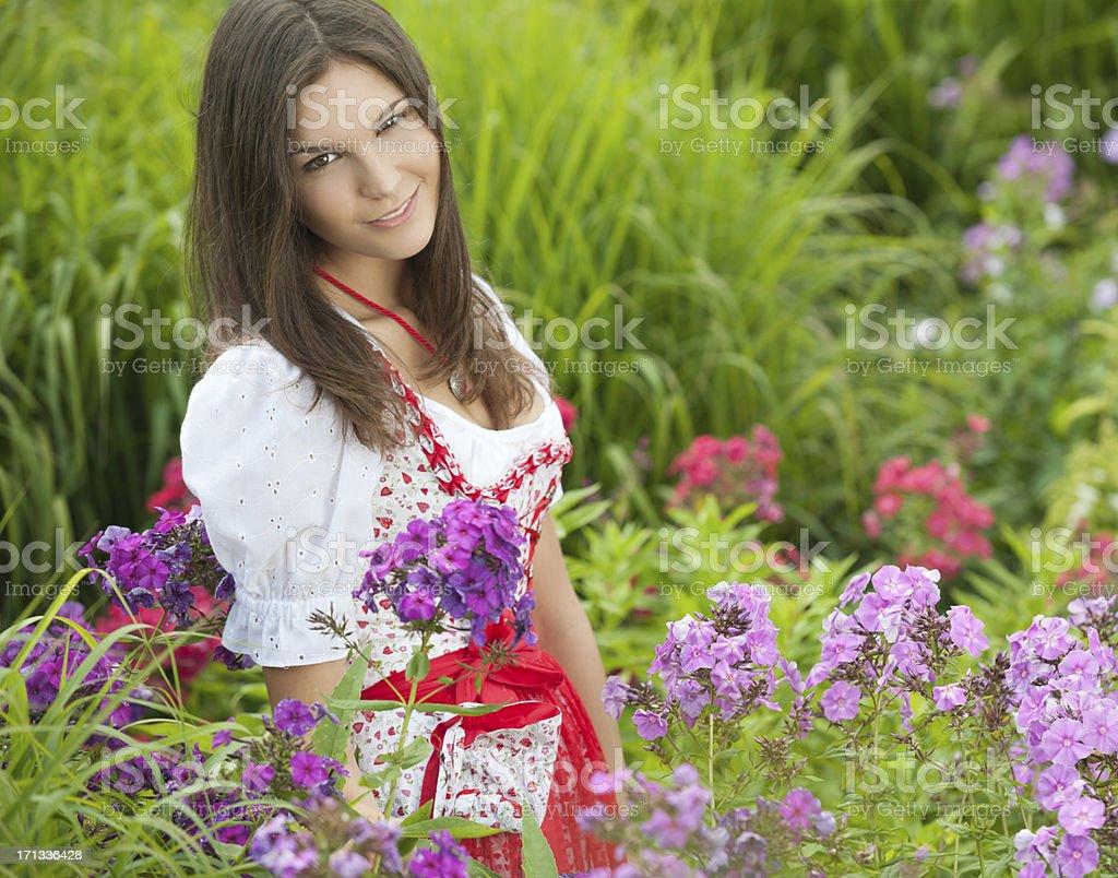 Beautiful woman wearing a Dirndl Dress, Flower Garden stock photo