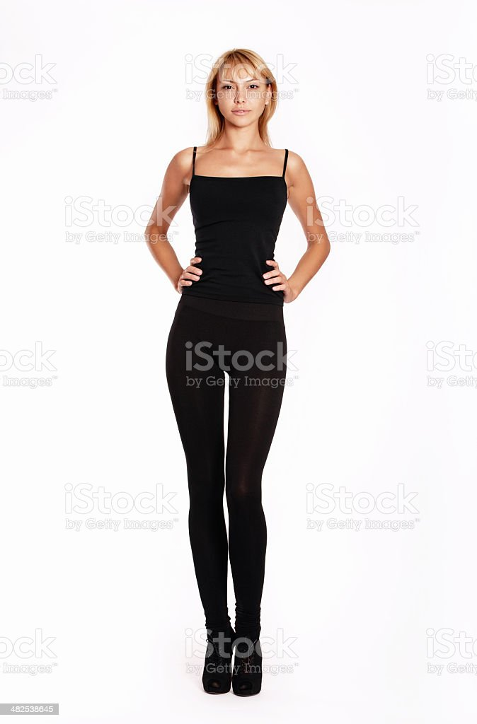 Beautiful woman wearing black against a white background stock photo
