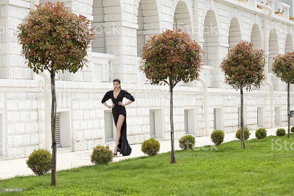 Beautiful woman wearing black dress royalty-free stock photo