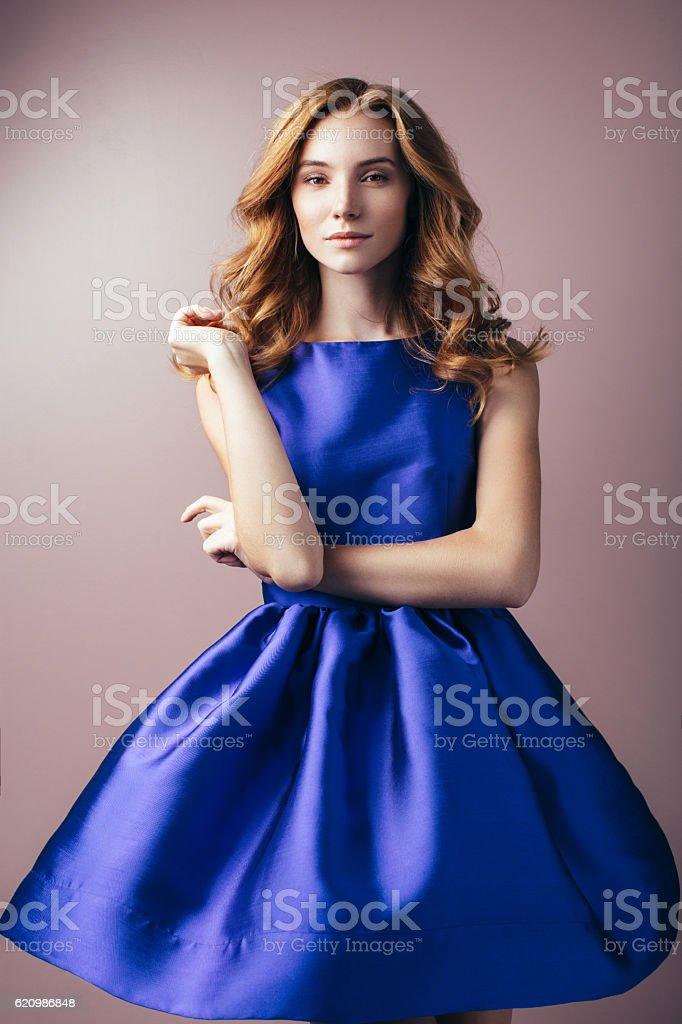 Beautiful woman wearing blue dress stock photo