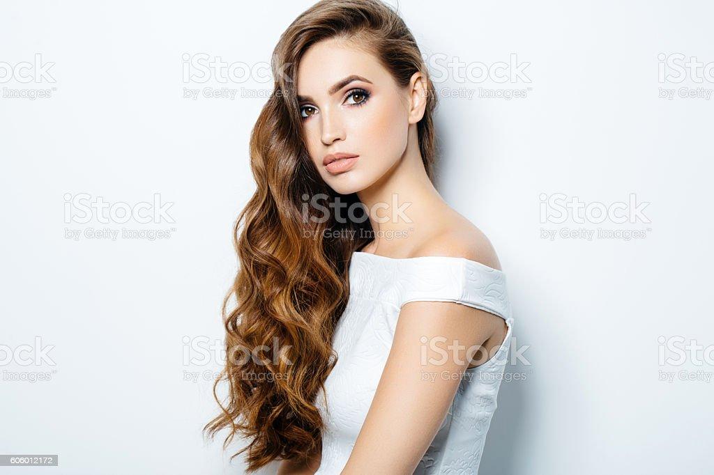 Beautiful woman wearing cocktail dress stock photo