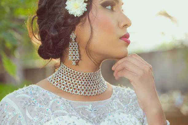 beautiful woman wearing diamond necklace outdoor stock photo