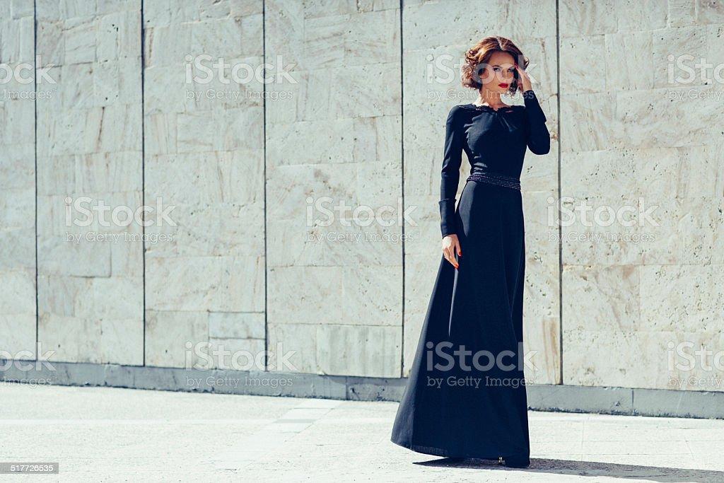 Beautiful woman wearing dress stock photo