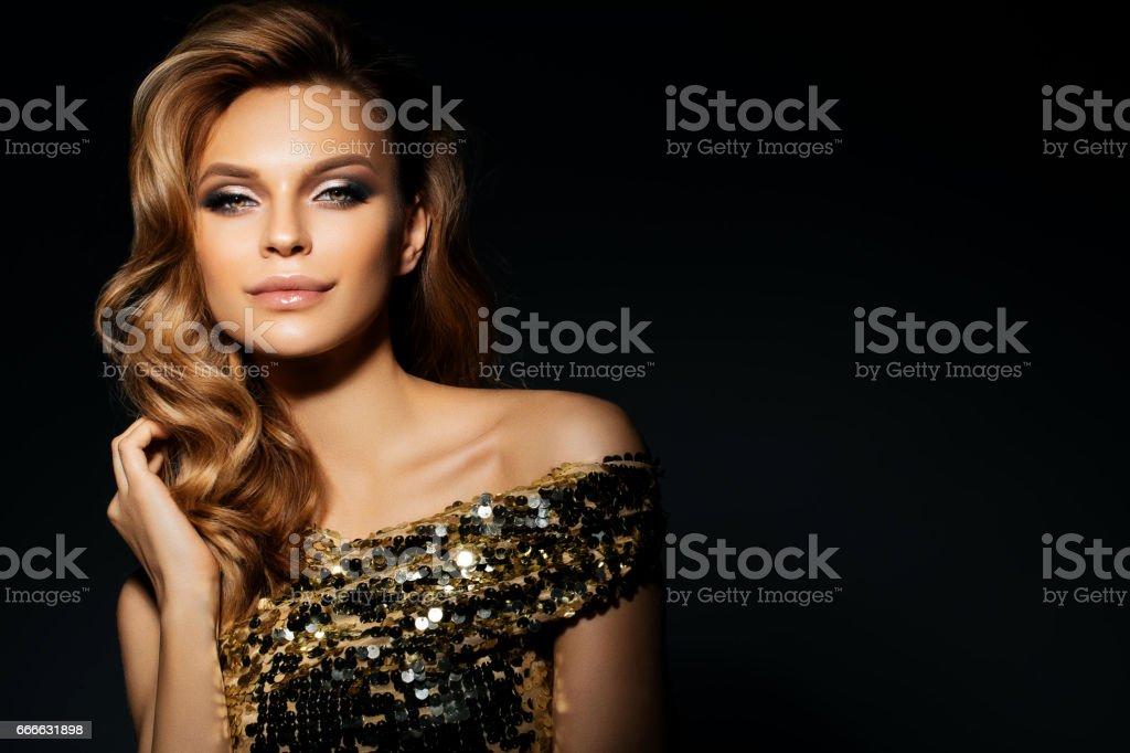 Beautiful woman wearing golden dress stock photo