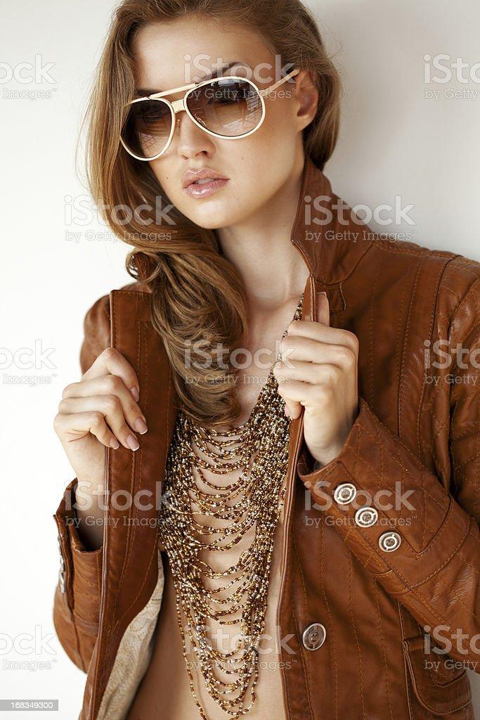 Beautiful woman wearing leather jacket royalty-free stock photo