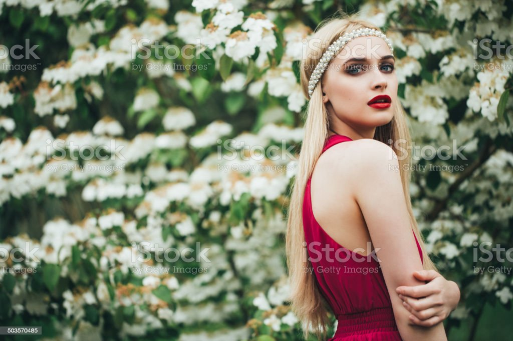 Beautiful woman wearing luxurious red dress stock photo