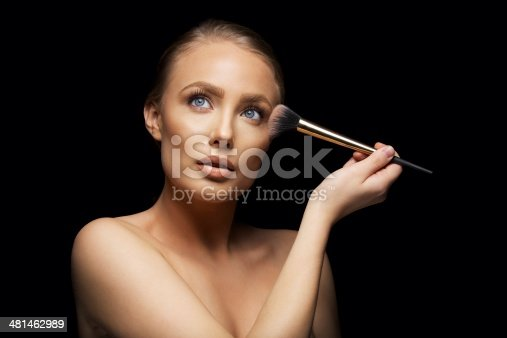 istock Beautiful woman wearing make up 481462989