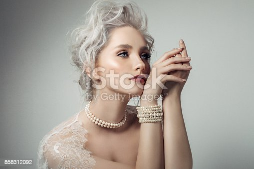Beautiful woman wearing pearls necklace