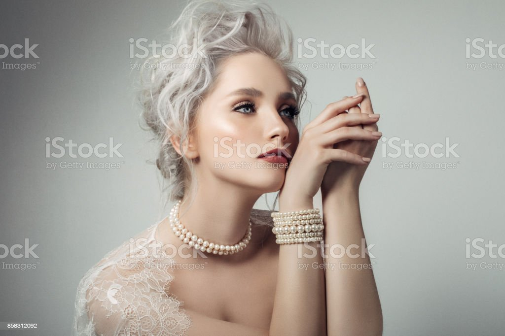 Beautiful woman wearing pearls necklace stock photo