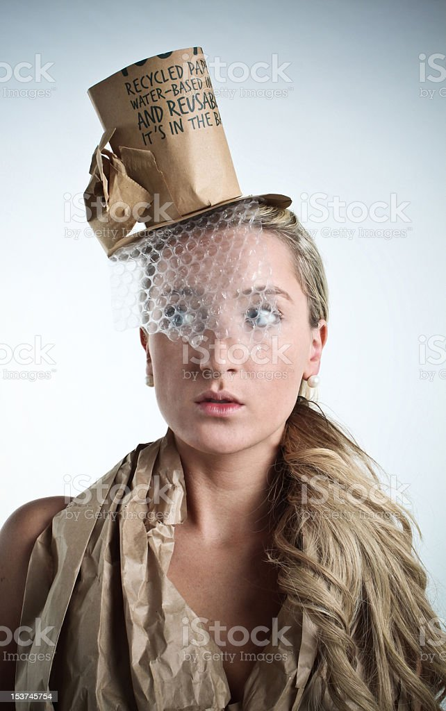 Beautiful woman wearing recycled clothes stock photo