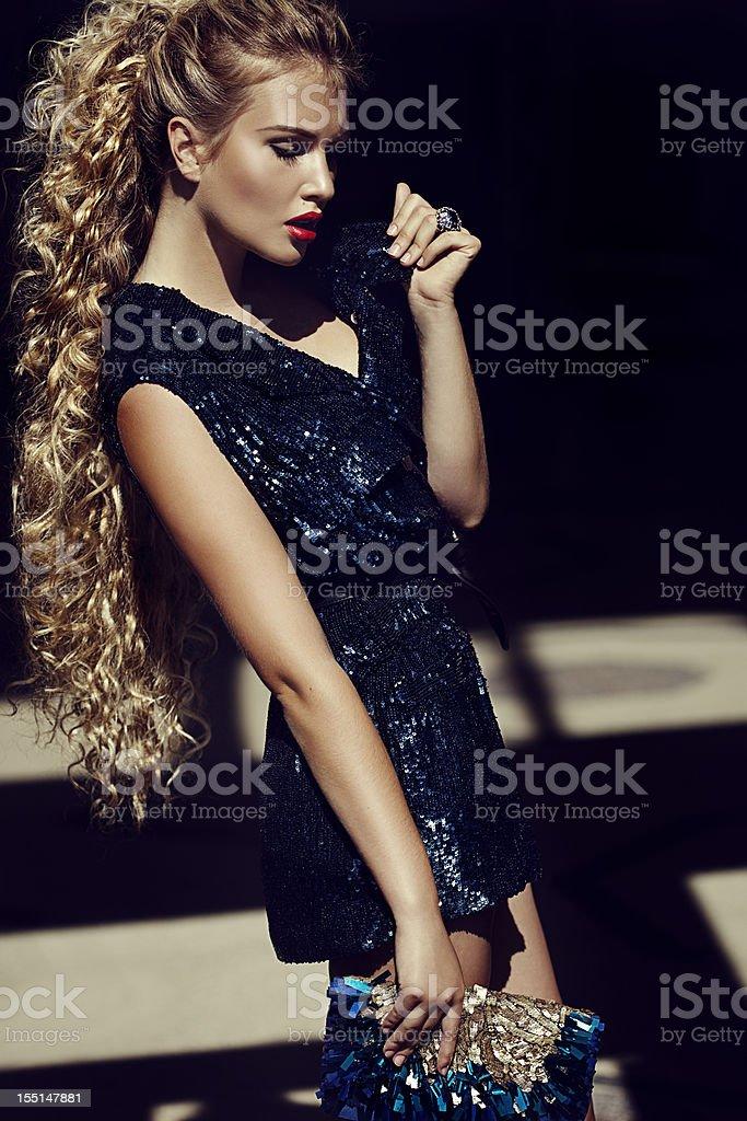 Beautiful woman wearing shiny dress royalty-free stock photo