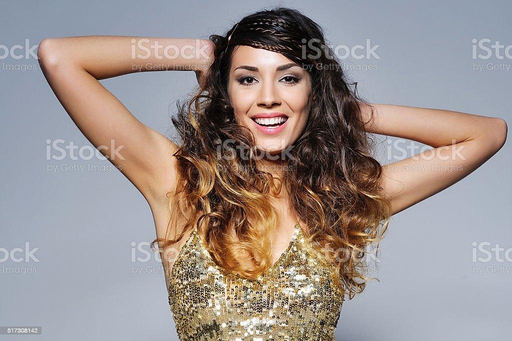 Beautiful woman wearing sparkling top stock photo
