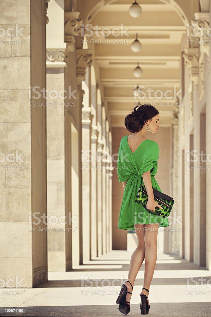 Beautiful woman wearing splendid dress stock photo