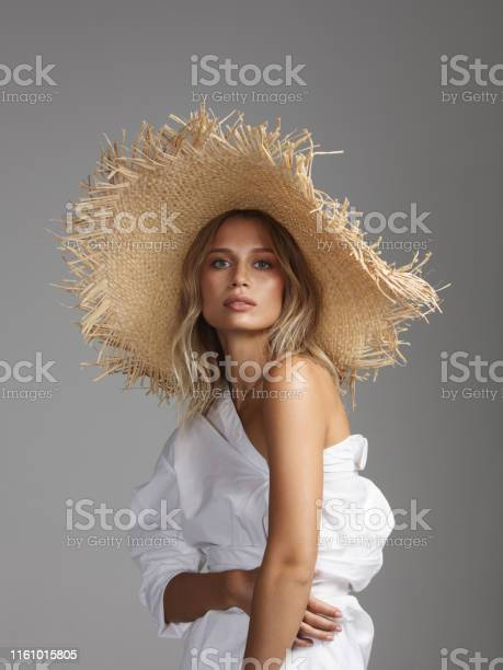 Beautiful woman wearing straw hat picture id1161015805?b=1&k=6&m=1161015805&s=612x612&h=khu6sxj6at8dmok x28hvme2dzo31b1cbrhkw91 oie=