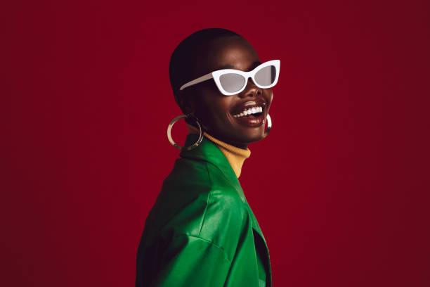 Beautiful woman wearing stylish sunglasses stock photo