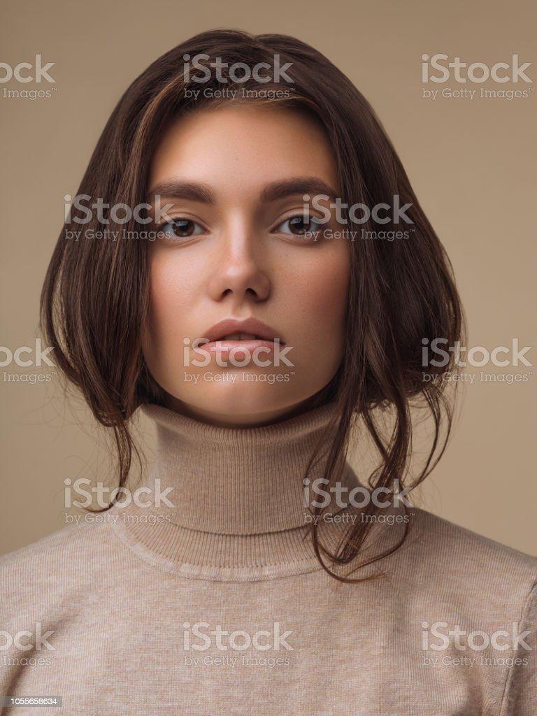 Beautiful woman wearing sweater stock photo