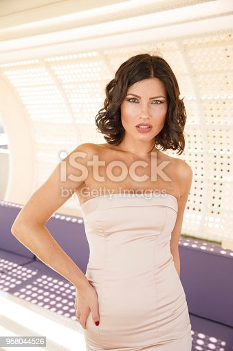 506798692 istock photo Beautiful woman wearing wedding dress. Fashion portrait young women dressed elegantly lifestyles. 958044526