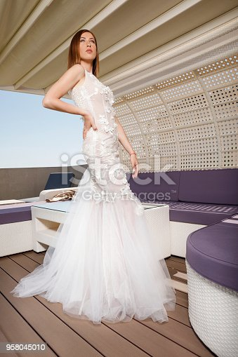 506798692 istock photo Beautiful woman wearing wedding dress. Fashion portrait young women dressed elegantly lifestyles. 958045010