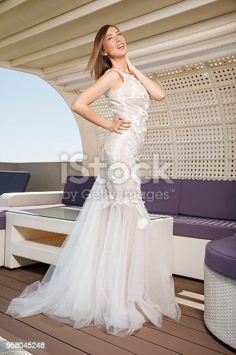 506798692 istock photo Beautiful woman wearing wedding dress. Fashion portrait young women dressed elegantly lifestyles. 958045248