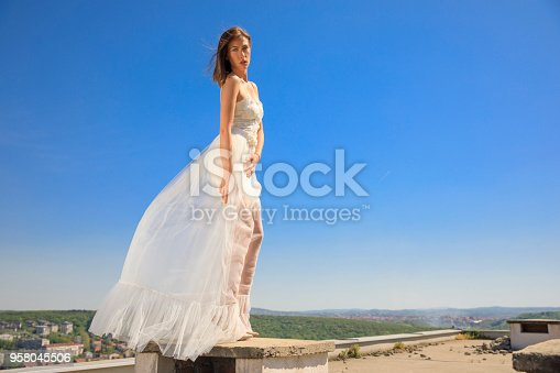 506798692 istock photo Beautiful woman wearing wedding dress. Fashion portrait young women dressed elegantly lifestyles. 958045506