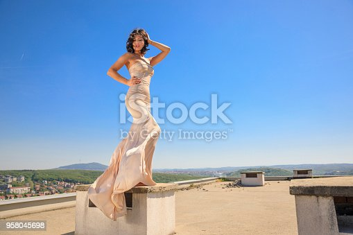 506798692 istock photo Beautiful woman wearing wedding dress. Fashion portrait young women dressed elegantly lifestyles. 958045698