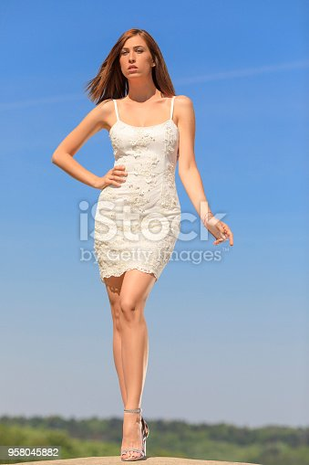 506798692 istock photo Beautiful woman wearing wedding dress. Fashion portrait young women dressed elegantly lifestyles. 958045882