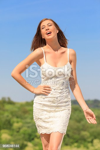 506798692 istock photo Beautiful woman wearing wedding dress. Fashion portrait young women dressed elegantly lifestyles. 958046144