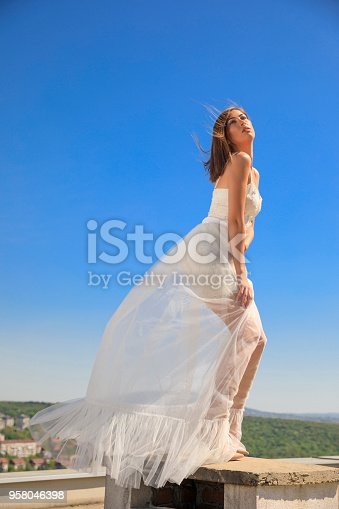 506798692 istock photo Beautiful woman wearing wedding dress. Fashion portrait young women dressed elegantly lifestyles. 958046398