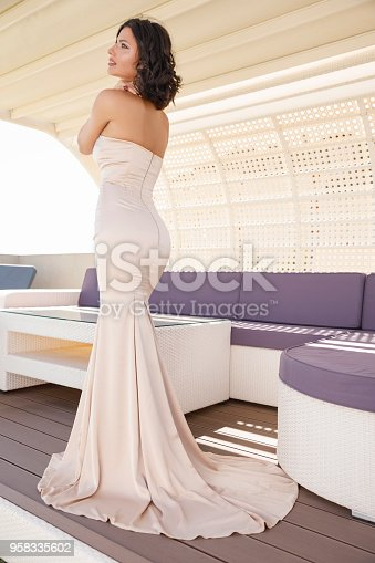 506798692 istock photo Beautiful woman wearing wedding dress. Fashion portrait young women dressed elegantly lifestyles. 958335602