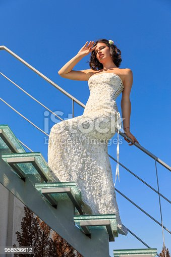 506798692 istock photo Beautiful woman wearing wedding dress. Fashion portrait young women dressed elegantly lifestyles. 958336612