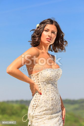 506798692 istock photo Beautiful woman wearing wedding dress. Fashion portrait young women dressed elegantly lifestyles. 958338922