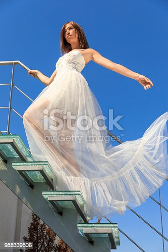 506798692 istock photo Beautiful woman wearing wedding dress. Fashion portrait young women dressed elegantly lifestyles. 958339506