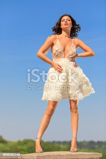 506798692 istock photo Beautiful woman wearing wedding dress. Fashion portrait young women dressed elegantly lifestyles. 959090248