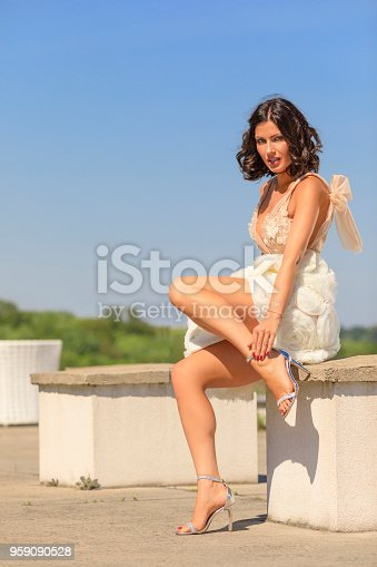 506798692 istock photo Beautiful woman wearing wedding dress. Fashion portrait young women dressed elegantly lifestyles. 959090528
