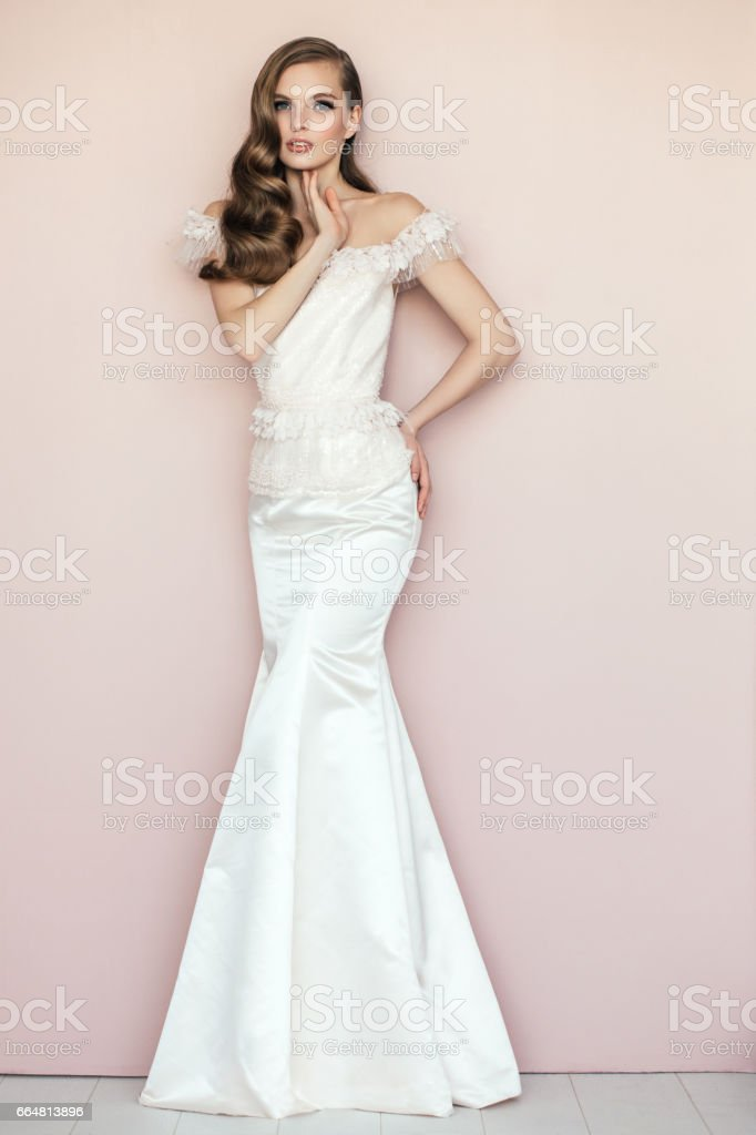 Beautiful woman wearing white dress stock photo